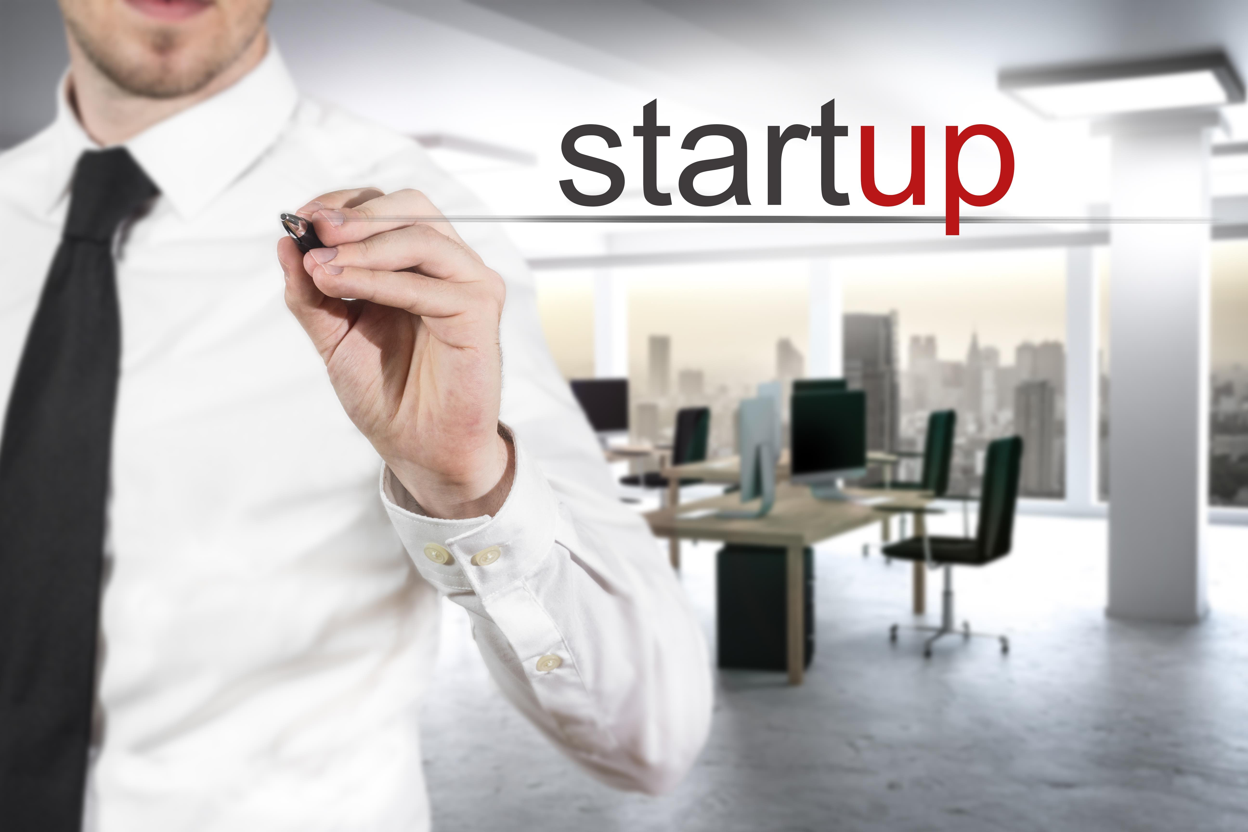 businessman in modern office writing startup